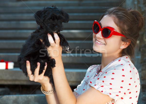 Young brunette woman hugging her lap dog puppy Stock photo © dashapetrenko