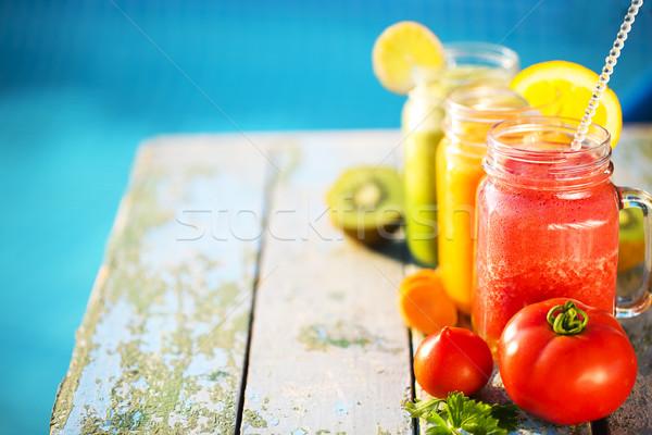 Three glasses of vegetable and fruit juice Stock photo © dashapetrenko