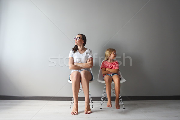Stock photo: Furious young mother in a discussion with her little daughter
