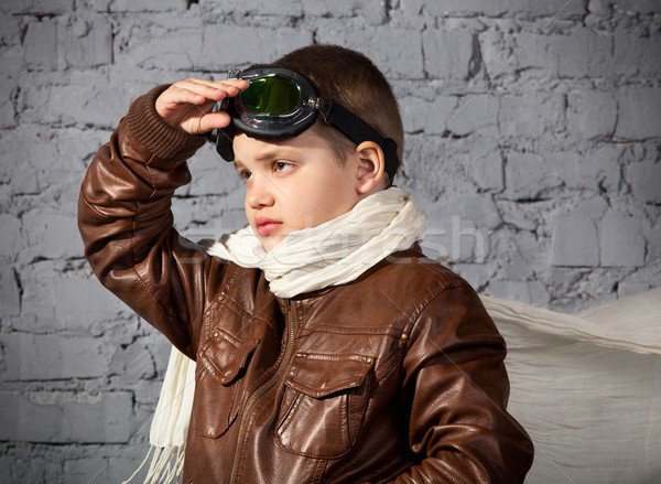 Little boy dreaming of becoming a pilot  Stock photo © dashapetrenko