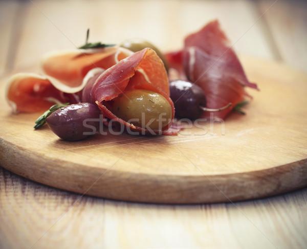 Prosciutto olives romarin bois restaurant viande Photo stock © dashapetrenko