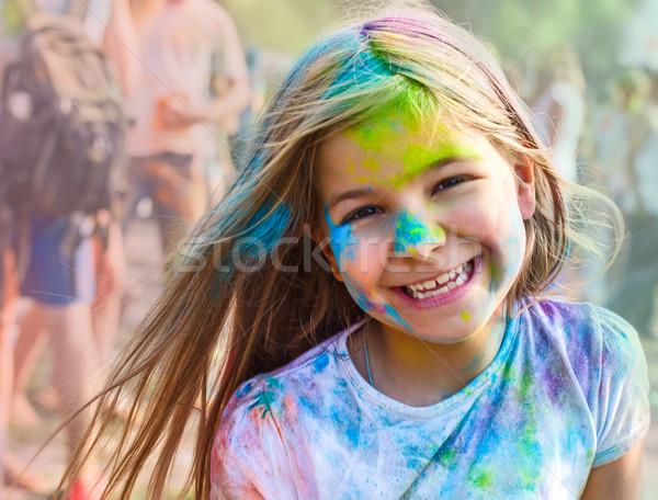 Portrait of happy litttle girl on holi color festival Stock photo © dashapetrenko