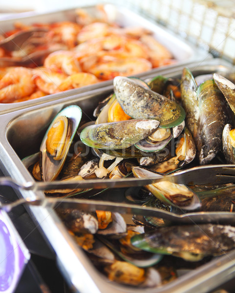 Buffet table with seafood with shrimps, fried calamari rings and Stock photo © dashapetrenko