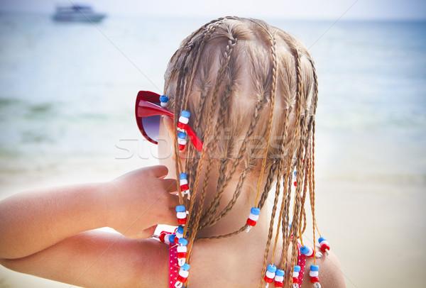 Cute little with dreadlocks girl on tropical beach Stock photo © dashapetrenko