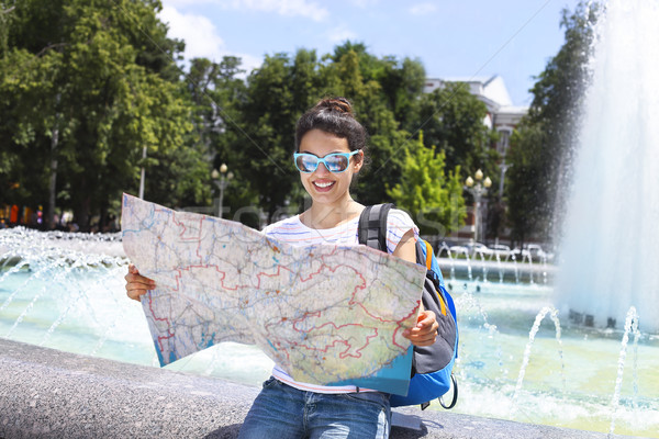 Tourist woman searching direction on location map Stock photo © dashapetrenko