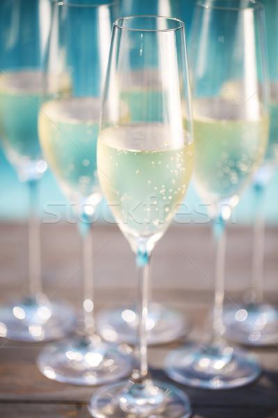 Champagne verres bois piscine été fête Photo stock © dashapetrenko