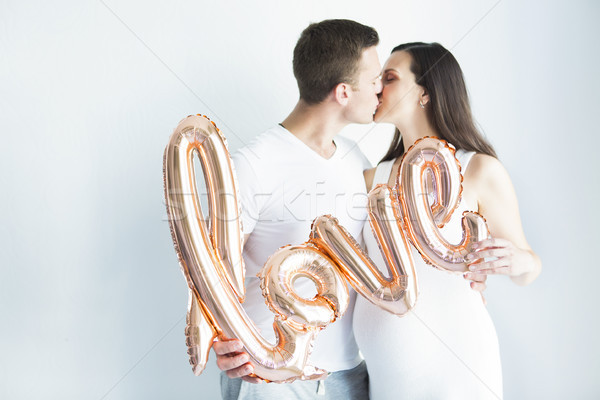 Young happy pregnant woman and man in love Stock photo © dashapetrenko