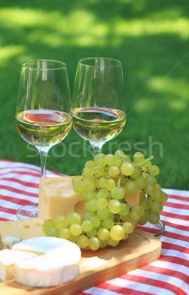 Various sorts of cheese with white wine Stock photo © dashapetrenko