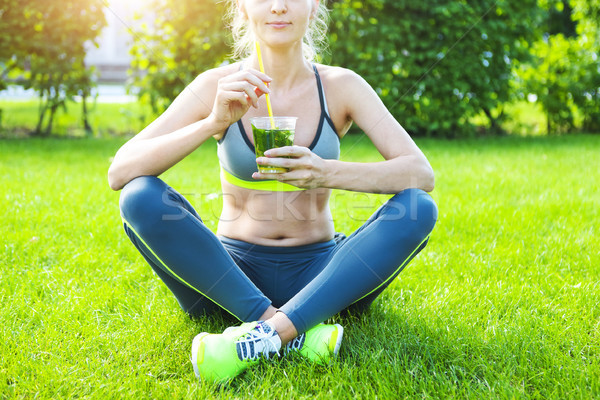 Woman drinking after fitness running workout on summer day. Stock photo © dashapetrenko
