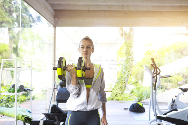 Woman training on a treadmill in a sport centre  Stock photo © dashapetrenko