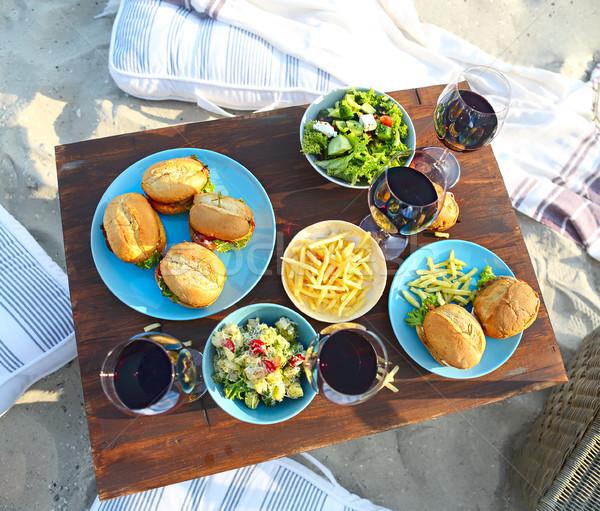 Piknik asztal vörösbor szemüveg tengerpart nyár étel Stock fotó © dashapetrenko