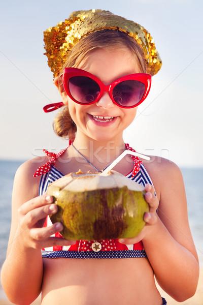 мало прелестный девушки питьевой кокосовое молоко пляж Сток-фото © dashapetrenko