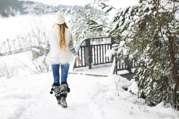 Young woman walking at park covered with snow Stock photo © dashapetrenko