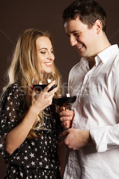 Young happy couple enjoying a glasses of wine Stock photo © dashapetrenko