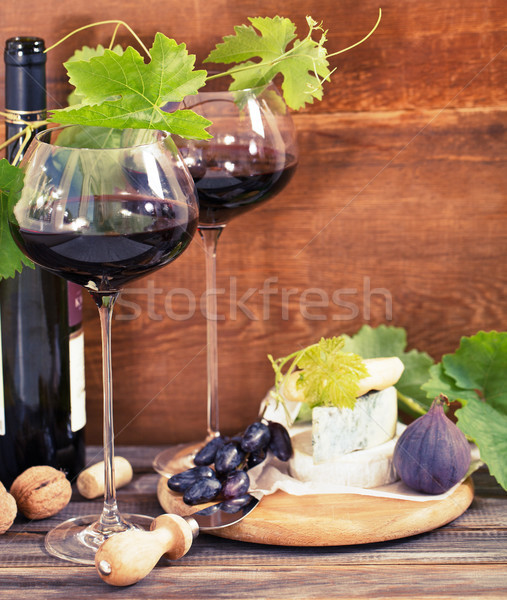 Still life with glasses of red wine and chesse Stock photo © dashapetrenko