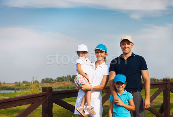 Happy young family in golf country club Stock photo © dashapetrenko