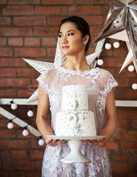 Cheerful bride holding wedding cake Stock photo © dashapetrenko