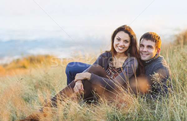Portrait of young happy couple laughing in a cold day by the sea Stock photo © dashapetrenko