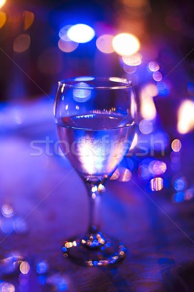 Wineglass outdoors on table by night Stock photo © dashapetrenko