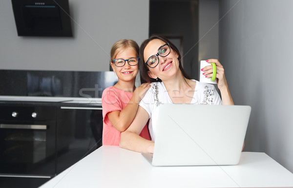 Mother working from home with little daughter Stock photo © dashapetrenko