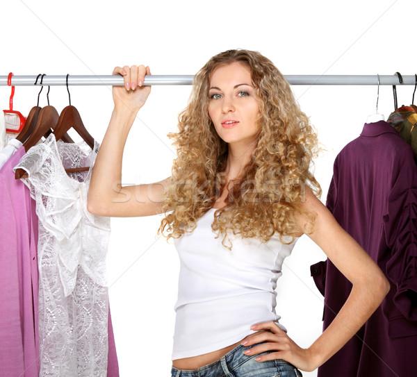Portrait of a blonde beautiful girl selecting clothes  Stock photo © dashapetrenko