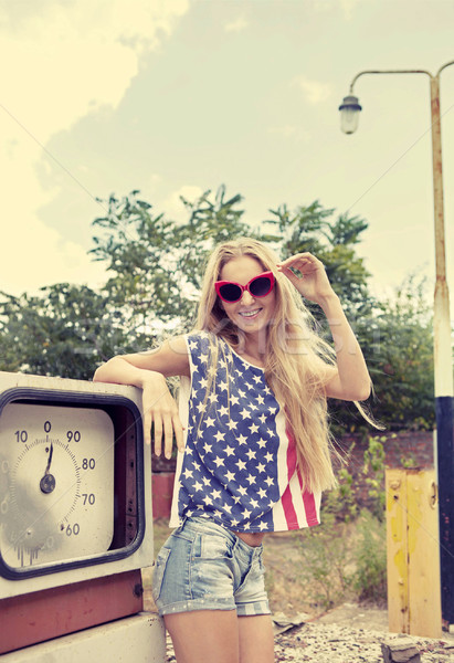 Stock photo: Blond girl on damaged gas station