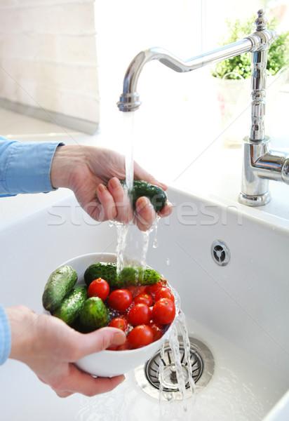 Immagine donna lavaggio pomodori cetrioli Foto d'archivio © dashapetrenko