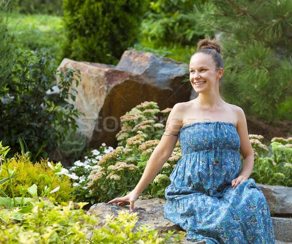 Beautiful pregnant woman relaxing in the park Stock photo © dashapetrenko