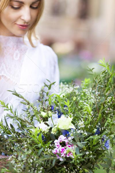 Beautiful wedding bouquet in the hands of the bride Stock photo © dashapetrenko