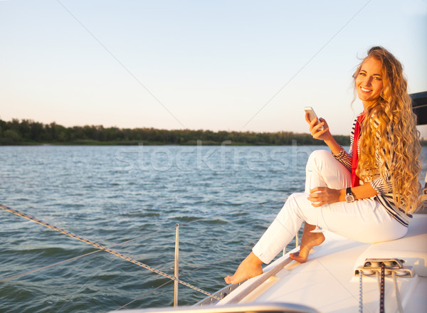 Summer woman on boat taking a picture Stock photo © dashapetrenko