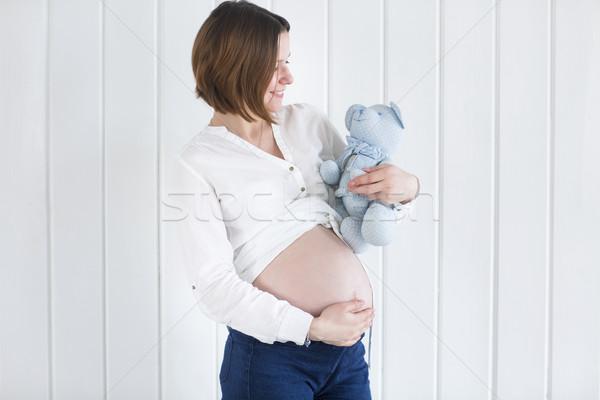 Pregnant woman holding a teddy bear Stock photo © dashapetrenko