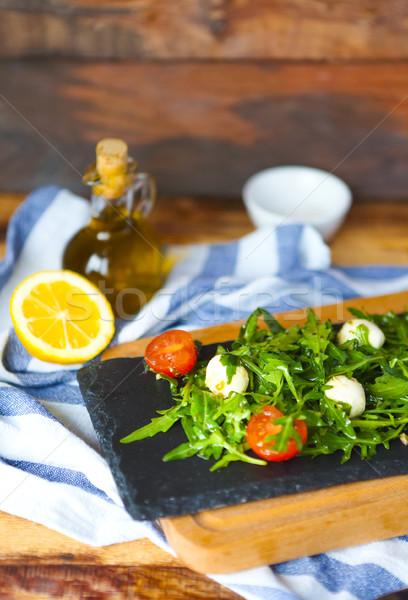 Taze İtalyan caprese salatası mozzarella domates karanlık Stok fotoğraf © dashapetrenko