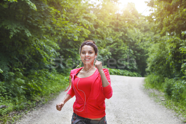Young lady running on a rural road in the morning Stock photo © dashapetrenko