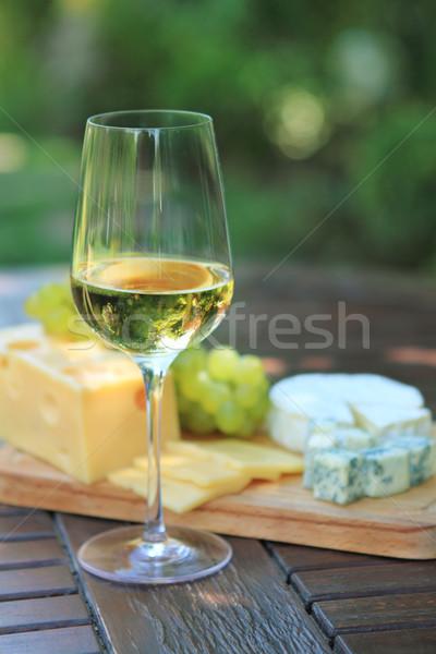 Various sorts of cheese, grapes and white wine Stock photo © dashapetrenko
