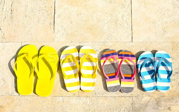 Papucs kő nyári vakáció tengerpart család gyerekek Stock fotó © dashapetrenko