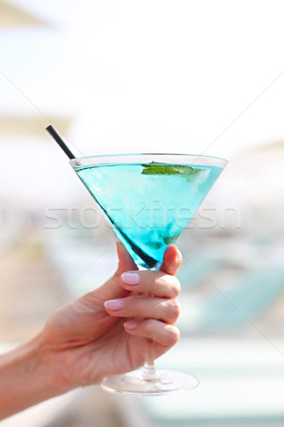 Exotic cocktail glass in womans hand Stock photo © dashapetrenko