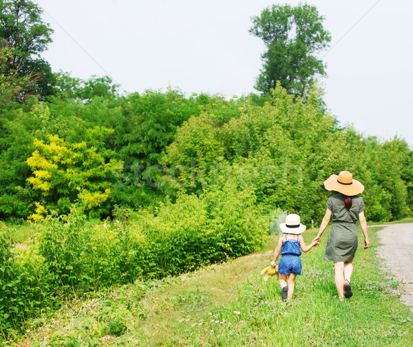 Happy mother and her little daughter walking  Stock photo © dashapetrenko