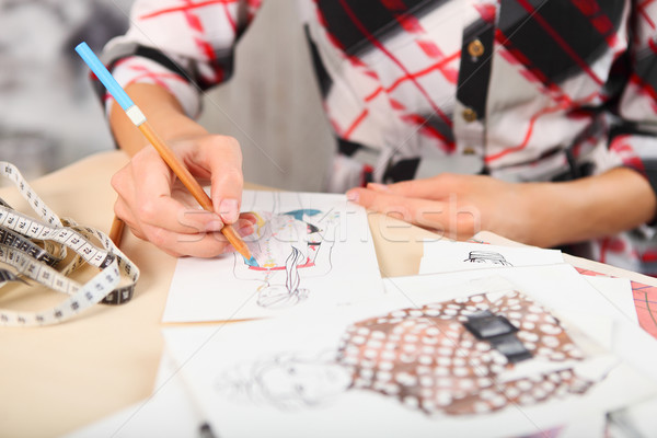 Dressmaker is drawing a fashion sketch Stock photo © dashapetrenko