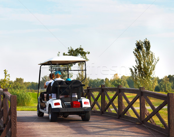 Young sportive people in the golfcar Stock photo © dashapetrenko