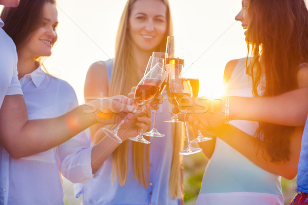 Group of friends toasting champagne sparkling wine at the beach Stock photo © dashapetrenko