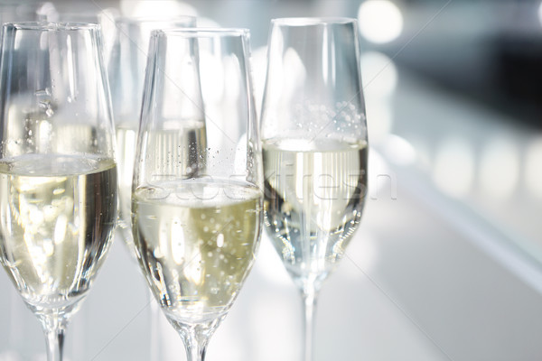 Champagne glasses on white background in bright lights Stock photo © dashapetrenko