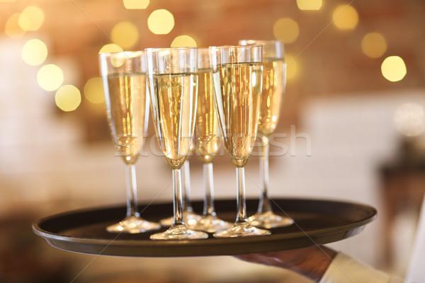 Champanhe óculos bandeja brilhante luzes festa Foto stock © dashapetrenko