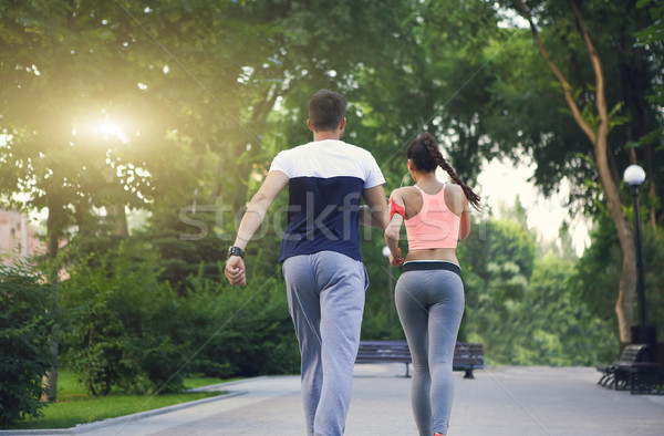 Couple jogging outside, runners training outdoors working out in Stock photo © dashapetrenko