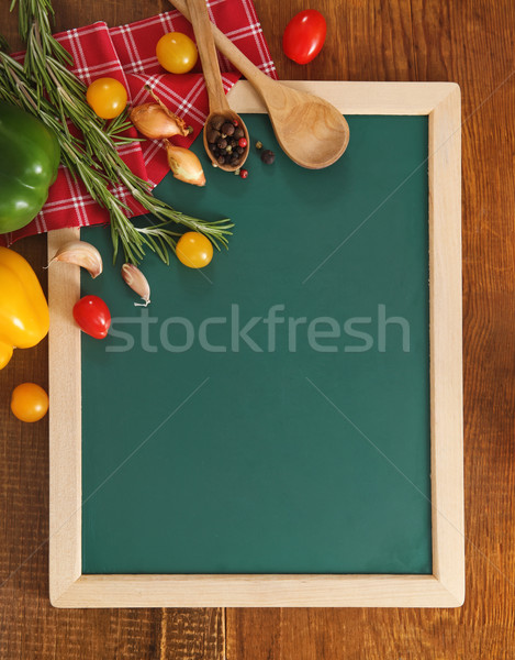 Vegetables still life with green board  Stock photo © dashapetrenko