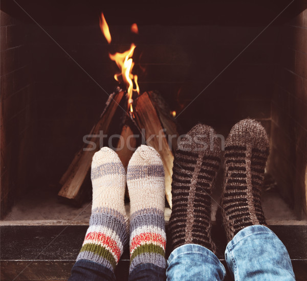Romantic legs of a couple in socks in front of fireplace at wint Stock photo © dashapetrenko