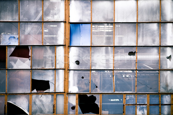 Broken windows of old industrial building Stock photo © dashapetrenko