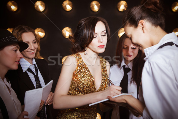 Superstar woman crowded by paparazzi Stock photo © dashapetrenko