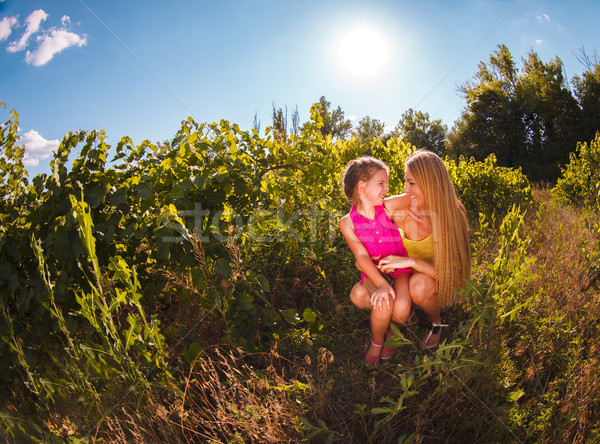 Stock photo: Happy mother and her little daughter in the vineyard
