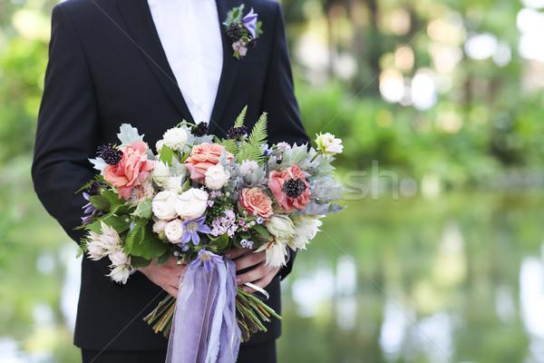 Groom holding beautiful bouquet in his hands Stock photo © dashapetrenko