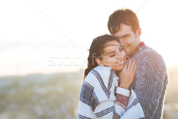 Young man and woman embrace and having fun outdoors Stock photo © dashapetrenko